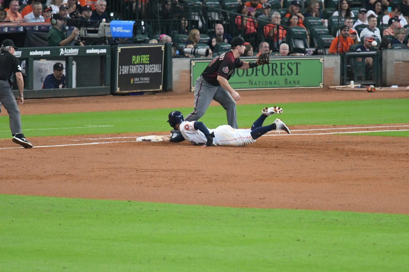 George Springer Sliding back safely to first