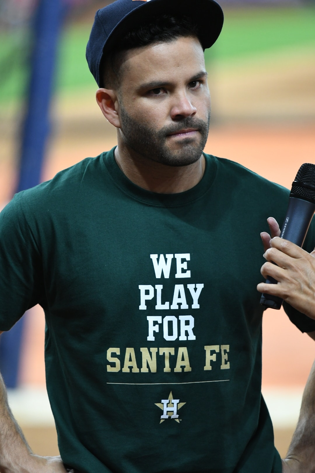 Jose Altuve, Wearing a We Play For Santa Fe shirt